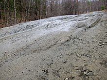 220px-Frost_heaves_on_Bragg_Hill_Road_in_Norwich_Vermont_in_March_2012--C